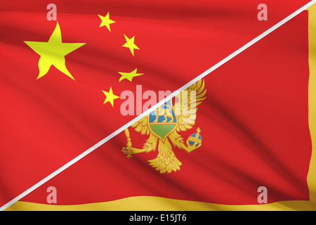 Flags of China and Montenegro blowing in the wind. Part of a series. - Stock Photo