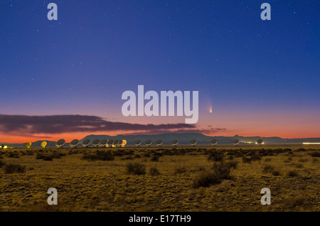 Comet PANSTARRS (C/2011 L4) over the VLA radio telescope array in New Mexico, March 17, 2013. - Stock Photo