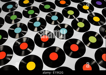 Colorful collection of vinyl records on grey background, angle view. Editable labels, the image is suitable for - Stock Photo