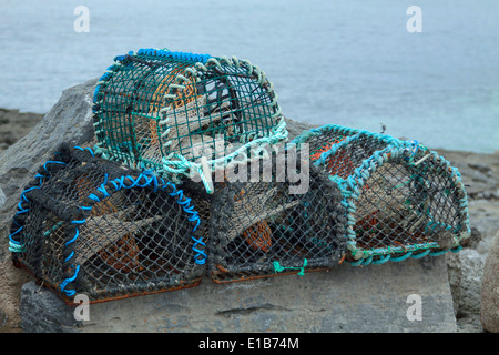 Lobster pots on the shore of Inis Oirr or Inisheer, one of the Aran Islands, Galway Bay, Republic of  Ireland. - Stock Photo