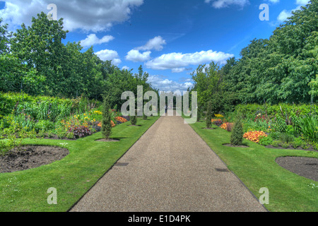 HDR image of flower beds and walkway in Regents Park, London, England - Stock Photo