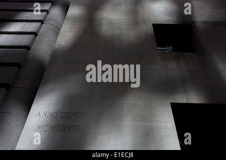 Detail of stone architecture dated anno domini 1928, on the surface of a wall on Wall Street, Lower Manhattan, New - Stock Photo