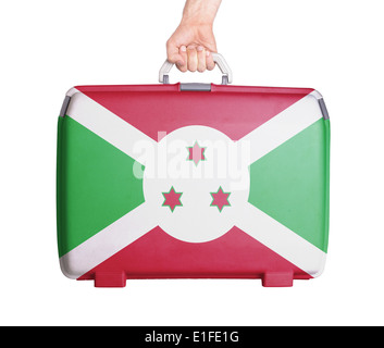 Used plastic suitcase with stains and scratches, printed with flag, Burundi - Stock Photo