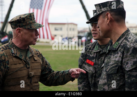 U.S. Marine Corps Lt. Gen. Kenneth J. Glueck, left, speaks with Korean service members before a change of command - Stock Photo