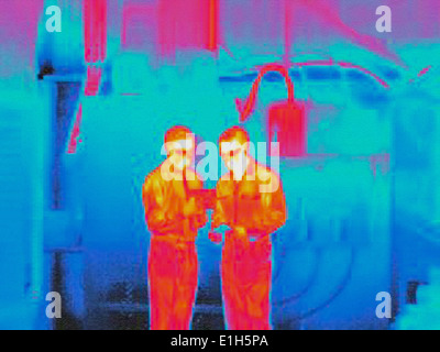 Infra red heat image of factory workers - Stock Photo