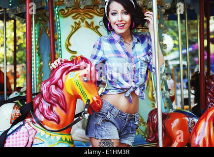 Rejoicing. Merriment. Excited Lively Woman in Funfair Smiling - Stock Photo