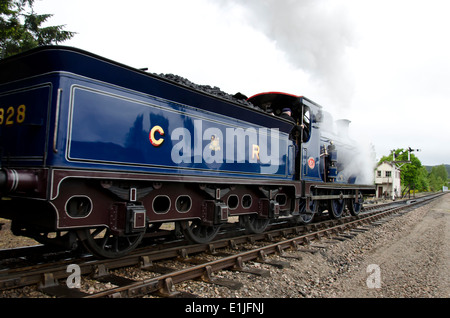 Steam train at Boat of Garten Station on the Strathspey Railway in the Scottish Highlands. - Stock Photo
