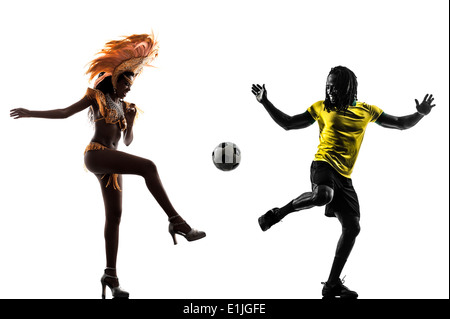 two Brazilian soccer football player man and Samba dancer woman in silhouette studio on white background - Stock Photo