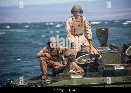 U.S. Marines assigned to Assault Amphibious Vehicle (AAV) Platoon, Kilo Company, Battalion Landing Team, 3rd Battalion, - Stock Photo