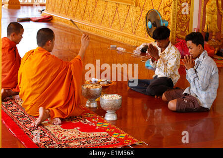 Buddhist ceremony in a cambodian Pagoda. - Stock Photo