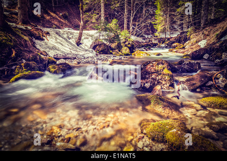 Vintage retro hipster style travel image of Cascade of Sibli-Wasserfall. Rottach-Egern, Bavaria, Germany - Stock Photo