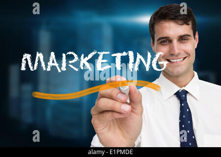 Businessman writing the word marketing - Stock Photo