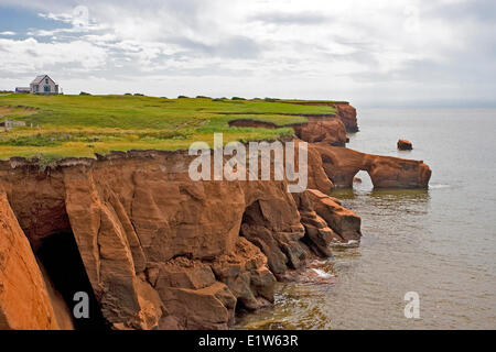 The typical rugged coastline Cap aux Meules  Magdalen Islands Iles de la Magedelaine Quebec. The small achipelago - Stock Photo