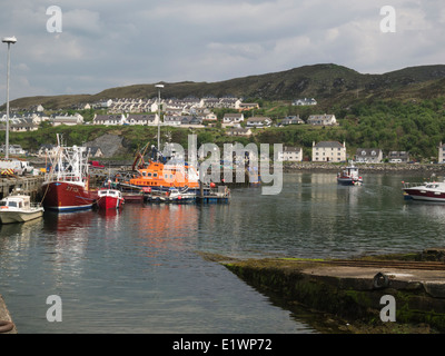 Fishing boats and lifeboat in Mallaig harbour on Scotland's west coast in the Highlands of Scotland a  port in Lochaber - Stock Photo