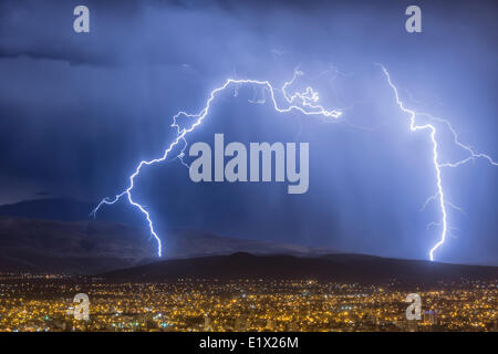 Lightning during a thunderstorm over the city of Cochabamba, Bolivia - Stock Photo