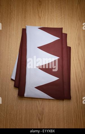 Folded Qatar flag - Stock Photo