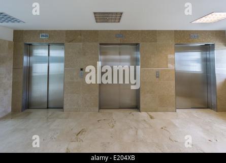 Modern elevators with closed doors - Stock Photo