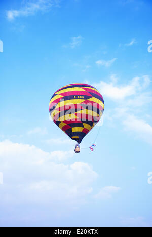 Brightly coloured hot air balloon - Stock Photo