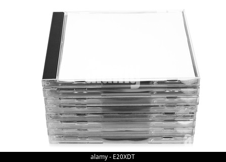 Stack of CD discs in boxes on white background - Stock Photo