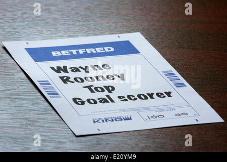 CHIPPENHAM, UK, 12th June, 2014. A Betting slip from the bookmaker Betfred betting that Wayne Rooney will be the - Stock Photo
