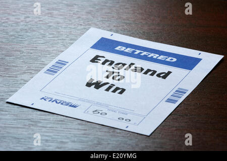 CHIPPENHAM, UK, 12th June, 2014. A Betting slip from the bookmaker Betfred betting that England will win the tournament - Stock Photo