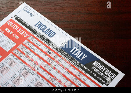 CHIPPENHAM, UK, 12th June, 2014. A Betting slip from the bookmaker Ladbrokes for Englands game against Italy is - Stock Photo