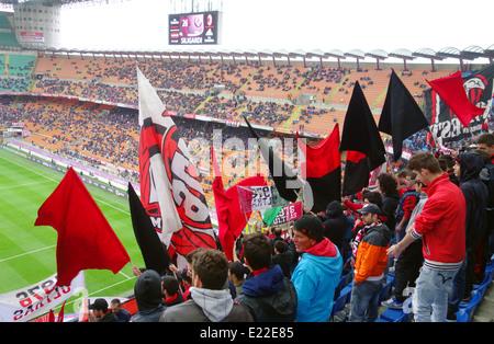 Milan fans at San Siro stadium in Milan, Italy - Stock Photo