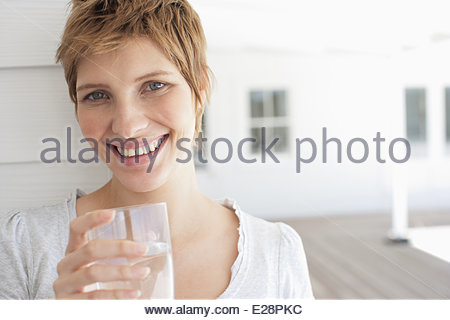 Pregnant woman drinking water - Stock Photo