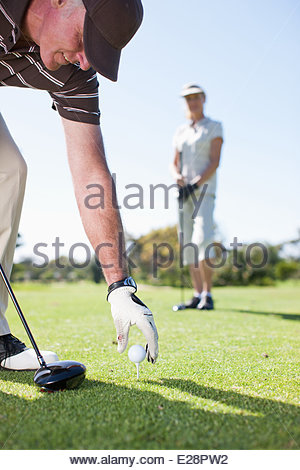Mature couple playing golf - Stock Photo