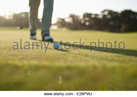 Man putting golf ball - Stock Photo