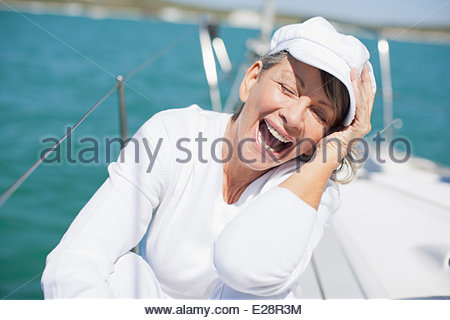 Woman sitting on deck of boat - Stock Photo
