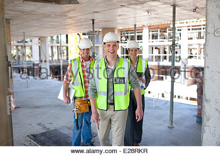 Construction workers standing on construction site - Stock Photo