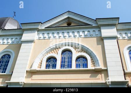 Bulgarian church with cross on blue sky - Stock Photo