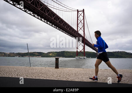 Portugal, Lisbon, Docas district, the 25 de Abril Bridge crosses the Tagus river - Stock Photo