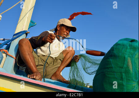 Indonesia, Lombok, Senggigi searesort, a fisherman on his traditional boat - Stock Photo