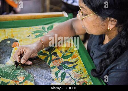 Sri Lanka, Central Province, Kandy District, Kandy, woman passing as some wax by successive layers to isolate colors - Stock Photo