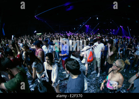 People dance during Sonar advanced music festival in Barcelona, Spain - Stock Photo
