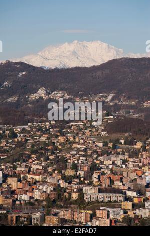 Switzerland, Ticino, Lugano, city and Monte Rosa from Monte Bre - Stock Photo