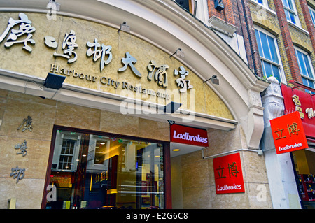 Exterior of restaurant in Chinatown s howing Ladbrokes, West End, City of Westminster, London, England, United Kingdom - Stock Photo