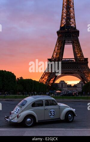 France Paris beatle car parked in front of Eiffel Tower - Stock Photo