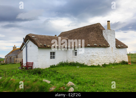 Youth Hostel in old thatched blackhouse cottage with whitewashed walls. Howmore South Uist Outer Hebrides Western - Stock Photo