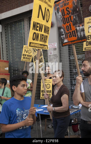 NY, NY, USA. 20th June, 2014. A coalition of groups picket in front of a military career center in Harlem, NYC. - Stock Photo