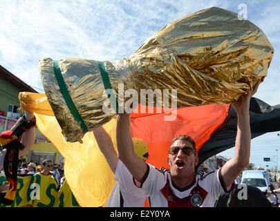 Fortaleza, Brazil. 21st June, 2014. Supporters of the German team cheer outside the stadium prior to the the FIFA - Stock Photo
