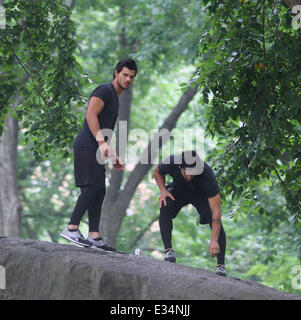 Taylor Lautner wows his fans flying from rock to rock on the film set of 'Tracers'  Featuring: Taylor Lautner Where: - Stock Photo