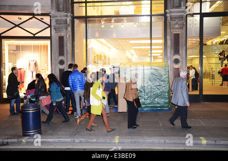 Fans queue up for the new iPhone 5 outside Apple's flagship store on Regent Street which will be released on Friday. - Stock Photo