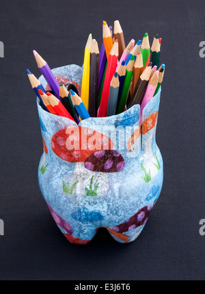 Colourful, collectable designer boxes, jar, vase, pencils imported from South Africa, made from recycled, reused, - Stock Photo