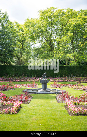 Formal garden with a water fountain statue, Regents Park, London, England, UK - Stock Photo