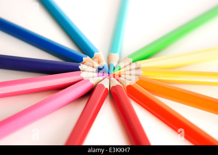 Rainbow color wheel made of colored pencils. On a white background with soft focus. - Stock Photo