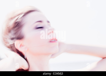 Close up and blurring, beautiful young brunette, windy and warm sunny day - Stock Photo