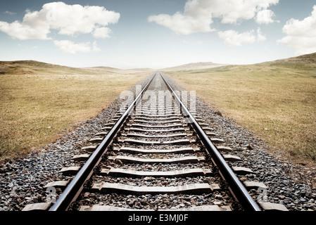 Railway Tracks. A long journey ahead. - Stock Photo